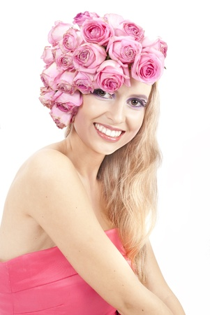 young beautiful woman with pink flowers on her head and in pink dress Stock Photo - 11385735