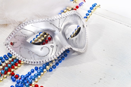 Background with Carnival silver Mask and color beads photo