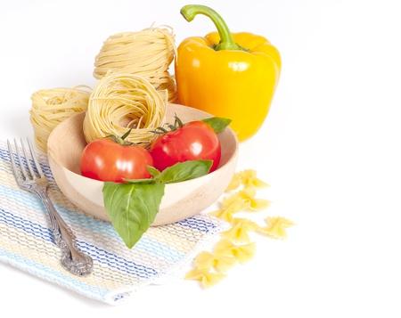 Tomato, macaroni, green basil, sweet pepper photo