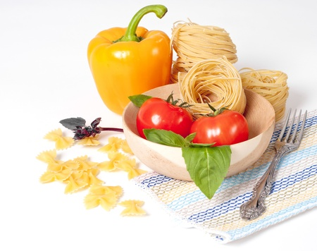 Tomato, macaroni, red and green basil, sweet pepper background photo
