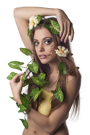 Beautiful young woman with flowers, leaves in her hair and original make up over white photo