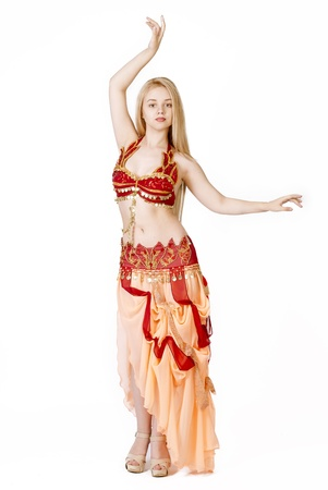 oriental ethnicity: beautiful young blonde - Arab Dancer, in great costume over white Stock Photo