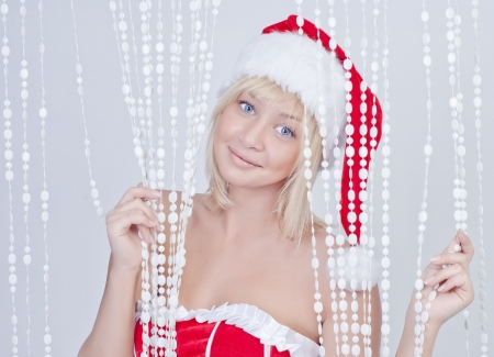 snow maiden: Beautiful smiling young woman in Santa Claus clothes with white beads