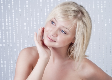 Beautiful smiling young woman with blond hair, portrait photo