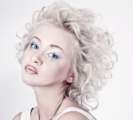 Attractive blond beauty portrait with original make up and hair dress photo
