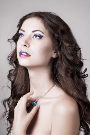 Bright blue eye make-up, beautiful woman portrait, Eyeshadows and lip stick photo