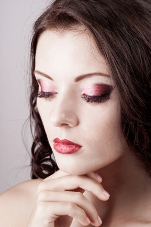 Bright blue eye evening make-up, beautiful woman portrait, Eyeshadows and lip stick photo