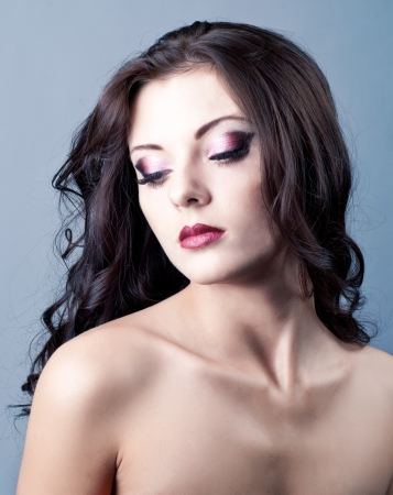 Bright purple eye evening make-up, beautiful woman portrait, Eyeshadows and lip stick photo