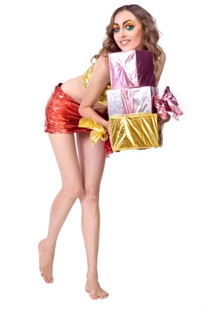 fashion smiling woman model with beauty bright make-up posing in studio with presents photo