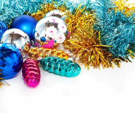 Color Christmas balls and toys background with gold tinsel Stock Photo
