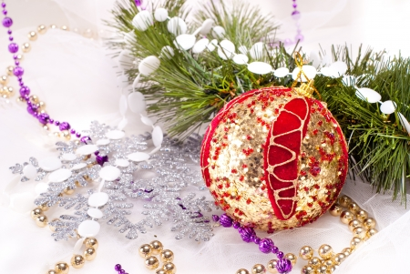 New year background with red decoration ball and fur tree branch photo