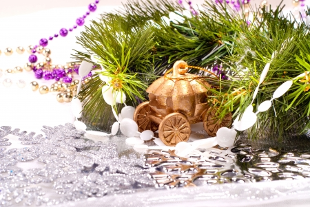 New year background with colorful decorative fur tree and toy carriage photo