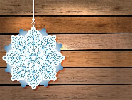 ferraille: Carte de Nouvel An avec flocon de neige dans le style papier d�coup� sur fond de bois Illustration