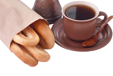 bagel: Cup of Coffee and bagels in paper bag over white Stock Photo