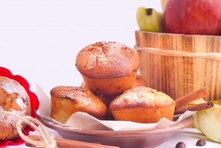 Muffin with apples and cinnamon sticks on the kitchen photo