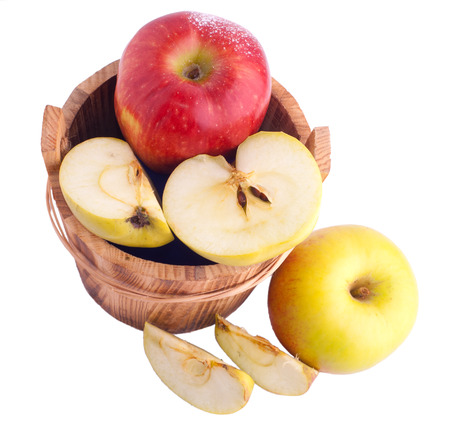 Apples in wooden bucket over white photo