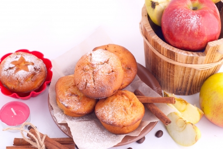Muffin with icing sugar star and cinnamon sticks photo