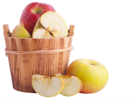 ambrosia: Apples in wooden bucket over white Stock Photo