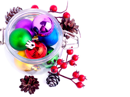 New Year bright color decoration ball in glass can over white photo