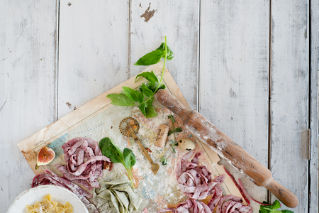 Raw homemade pasta nests over old map and wooden background Stock Photo