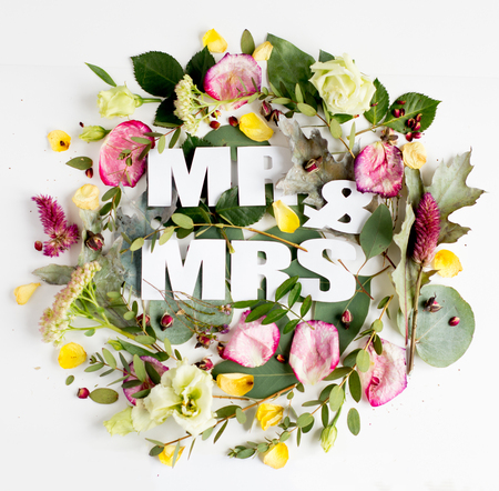 Flowers composition with word MR&MRS, Frame made of fresh flowers. Flat lay, top view