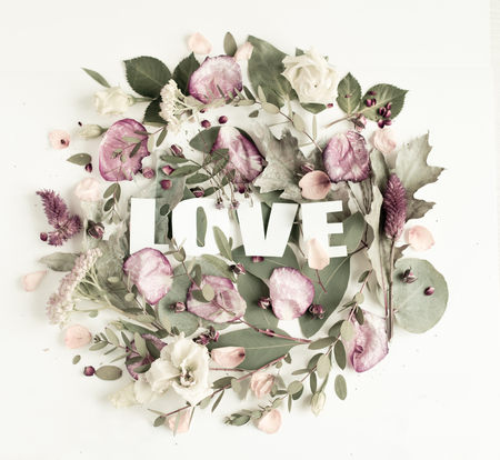 Flowers composition with word LOVE, Frame made of fresh flowers. Flat lay, top view Banco de Imagens