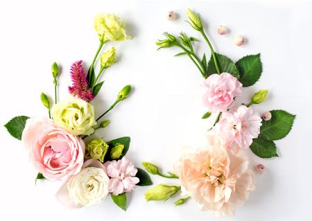 Flowers composition with place for text. Frame made of fresh flowers. Flat lay, top view