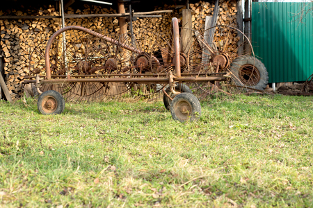 Mechanical rake used to windrow hay for drying Stock Photo