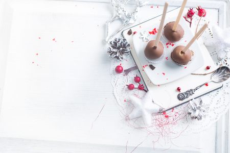 Chocolate cake pops over Christmas background Stock Photo