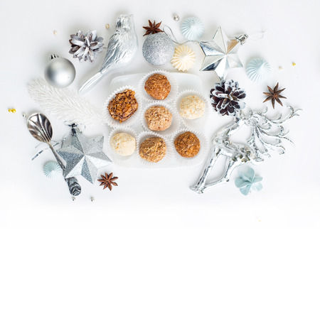 Homemade chocolate truffles, sweets over Christmas background