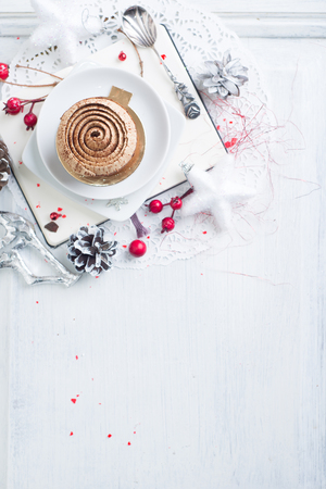 Cupcake with white brown cream over Christmas background Stock Photo
