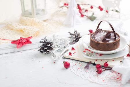 Beautiful Chocolate tart over Christmas background Stock Photo