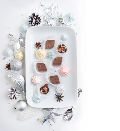 Homemade chocolate candies, sweets over Christmas background