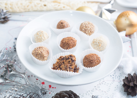 Homemade chocolate truffles, sweets over Christmas background Stock Photo - 90087696