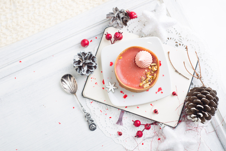 red fruit tart with meringues over Christmas background