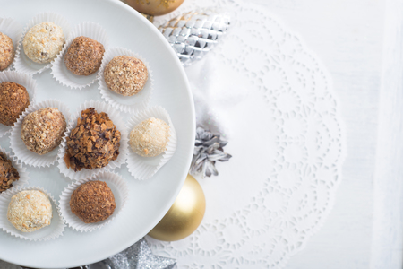 Homemade chocolate truffles, sweets over Christmas background Stock Photo