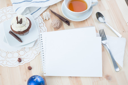 Chocolate cupcake with white cream over Christmas background Stock Photo
