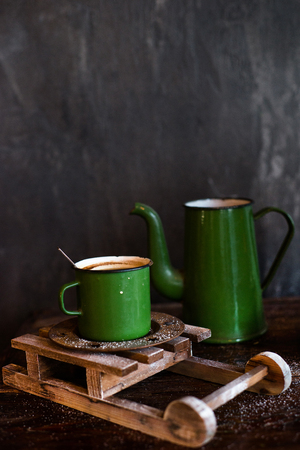 Green old style iron coffee pot and and green mug, dark still life Stok Fotoğraf