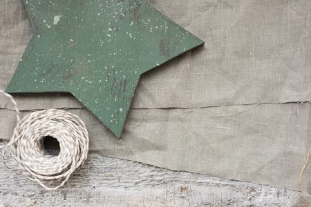 Wooden star and gray textile background for design