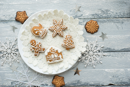 Beautiful background with gingerbread cookies, modern food still life, Christmas holiday card, rustic background
