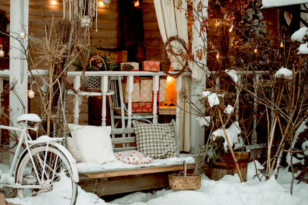 Christmas decorations for the holiday, a beautiful cozy home with a bench and decorations, Christmas arrangement