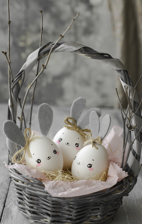 Easter decoration for home, handmade work, cute eggshell rabbit in a basket, beautiful  for card design