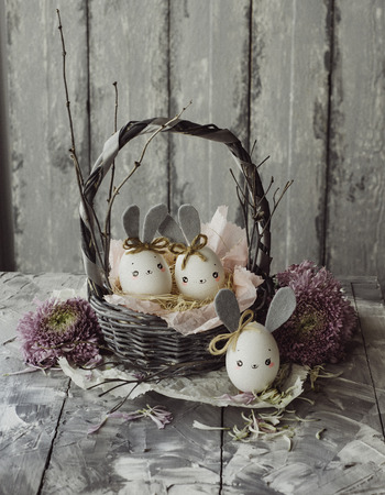 Easter decoration for home, handmade work, cute eggshell rabbit in a basket, beautiful  for card design Imagens - 118854610