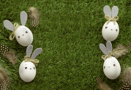 Easter decoration for home, handmade work, cute eggshell rabbits over green grass, beautiful  for card design 写真素材 - 118854476
