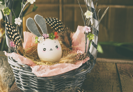 Easter decoration for home, handmade work, cute eggshell rabbit in a basket, beautiful  for card design Imagens - 118854474