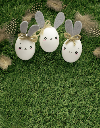 Easter decoration for home, handmade work, cute eggshell rabbits over green grass, beautiful  for card design 写真素材