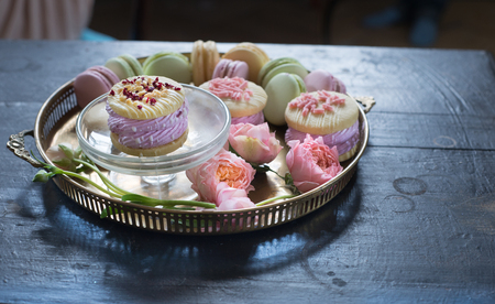 macaroon, Variety desserts of light colors on metal plate on wood table Reklamní fotografie