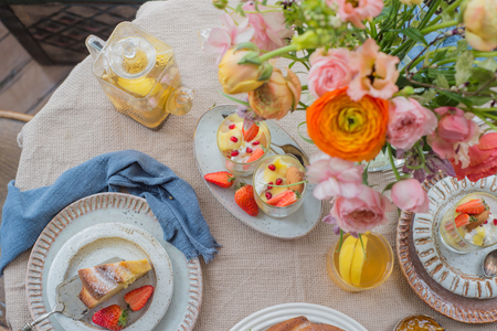 Cake, Pastry with blueberrys arranged on table with flowers and fruits, top view 写真素材