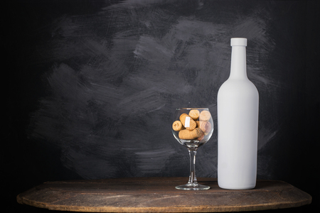 Wine bottle and glass on wooden background Stock Photo