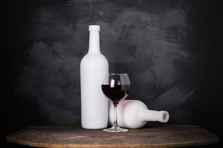 Wine bottle and glass on wooden background 写真素材
